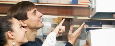 Young couple try to decide which boiler to choose