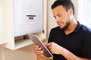 Gas Safe registered boiler engineer checks combi boiler