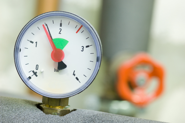 pressure gauge on a boiler showing green level